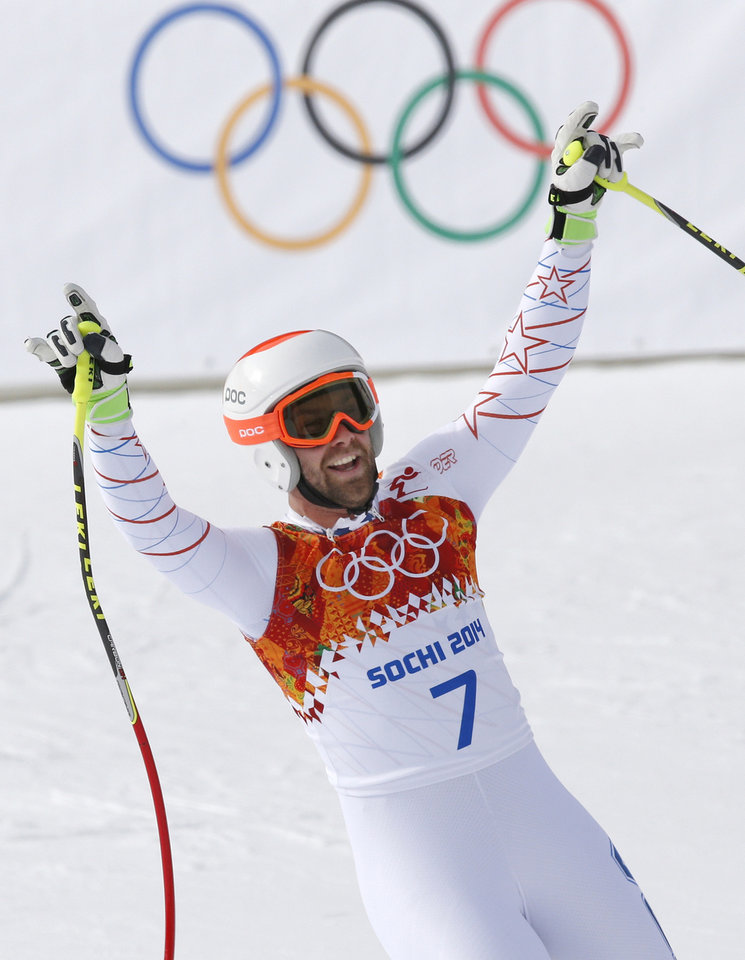 Photo - United States' Travis Ganong gestures after finishing the men's downhill at the Sochi 2014 Winter Olympics, Sunday, Feb. 9, 2014, in Krasnaya Polyana, Russia. (AP Photo/Christophe Ena)