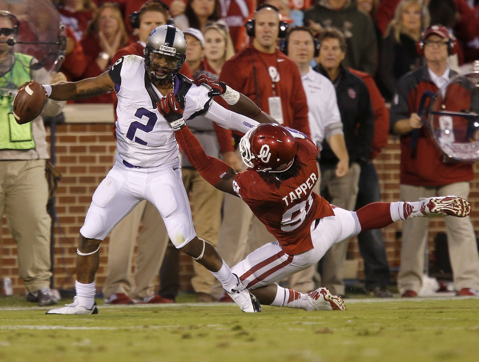 Oklahoma's Charles Tapper (91) brings down TCU's Trevone Boykin (2) during a college football game between the University of Oklahoma Sooners (OU) and the TCU Horned Frogs at Gaylord Family-Oklahoma Memorial Stadium in Norman, Okla., on Saturday, Oct. 5, 2013. Photo by Bryan Terry, The Oklahoman