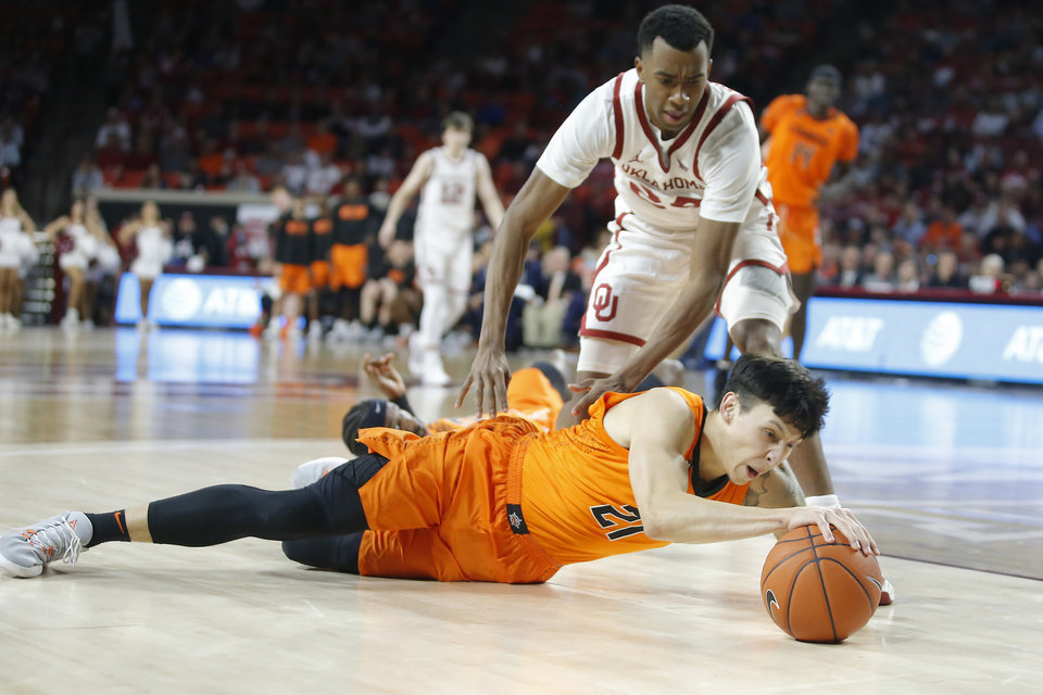 Photo - Oklahoma State's Lindy Waters III (21) dives for the ball in front of Oklahoma's Jamal Bieniemy (24) during a Bedlam college basketball game between the University Oklahoma Sooners (OU) and the Oklahoma State Cowboys (OSU) at the Lloyd Noble Center in Norman, Okla., Saturday, Feb. 1, 2020. Oklahoma won 82-69. [Bryan Terry/The Oklahoman]