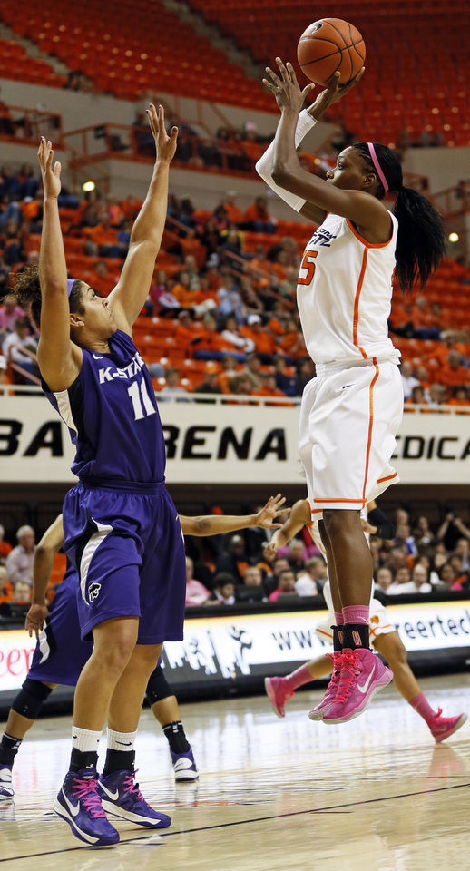 Photo - Oklahoma State's Toni Young (15) shoots over Kansas State's Chantay Caron (11) during an NCAA women's basketball game between Oklahoma State University (OSU) and Kansas State at Gallagher-Iba Arena in Stillwater, Okla., Saturday, Feb. 16, 2013. Photo by Nate Billings, The Oklahoman