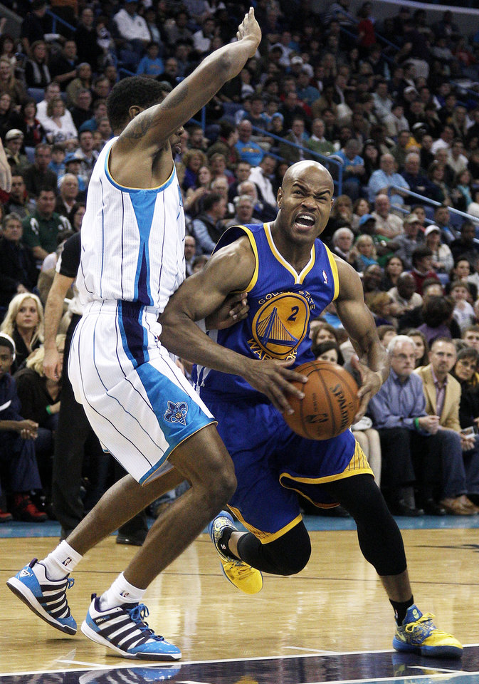 Photo - Golden State Warriors guard Jarrett Jack (2) drives past New Orleans Hornets guard Roger Mason Jr. during the first half of an NBA basketball game in New Orleans, Saturday, Jan. 19, 2013. (AP Photo/Jonathan Bachman)