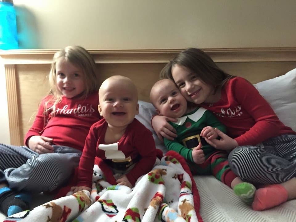 Photo -  During the 10 Strong Christmas Eve pajama party, Blake Howard poses with his sisters. Blake had just finished a stem cell transplant and was not able to attend the party with the rest of the kids on the 10th floor at OU Children's Hospital. From left are Victoria, Blake, Violet and Valerie Howard. Blake died March 26. [Photo provided]