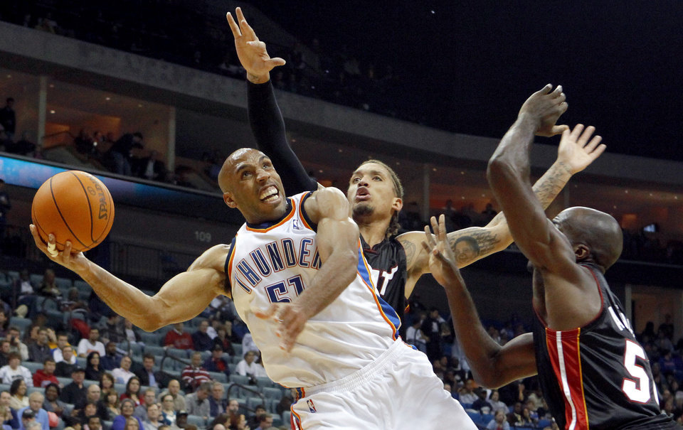Oklahoma City's Michael Ruffin shoots the ball beside Miami's Michael Beasley, center, and Joel Anthony during an NBA preseason game between the Oklahoma City Thunder and the Miami Heat at the BOK Center in Tulsa, Okla., Wednesday, October 14, 2009. Photo by Bryan Terry, The Oklahoman