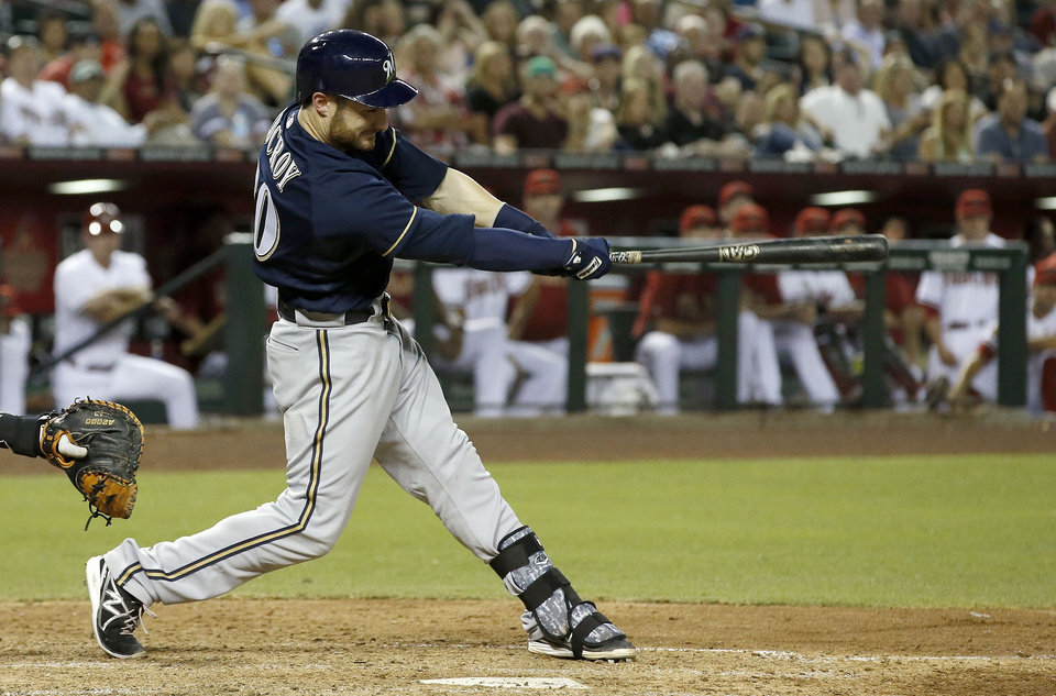 Photo - Milwaukee Brewers' Jonathan Lucroy connects for a grand slam against the Arizona Diamondbacks during the seventh inning of a baseball game on Tuesday, June 17, 2014, in Phoenix. (AP Photo/Ross D. Franklin)