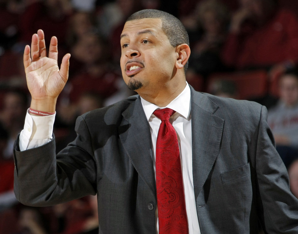 Photo - OU head coach Jeff Capel gives instructions to his team in the second half of the men's college basketball game between the University of Colorado and the University of Oklahoma at Lloyd Noble Center in Norman, Okla., Saturday, Jan. 22, 2011. OU won, 67-60. Photo by Nate Billings, The Oklahoman ORG XMIT: KOD