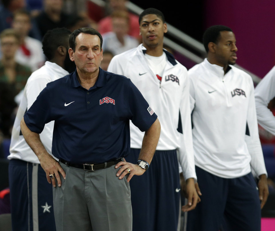 United States\' coach Michael Krzyzewski watches during the men\'s gold medal basketball game against Spain at the 2012 Summer Olympics, Sunday, Aug. 12, 2012, in London. (AP Photo/Charles Krupa)