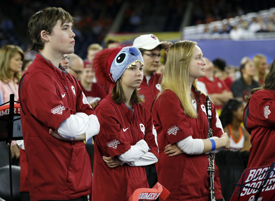 Photo - Members of the Oklahoma band watch the national semifinal between the Oklahoma Sooners (OU) and the Villanova Wildcats in the Final Four of the NCAA Men's Basketball Championship at NRG Stadium in Houston, Saturday, April 2, 2016. Photo by Nate Billings, The Oklahoman