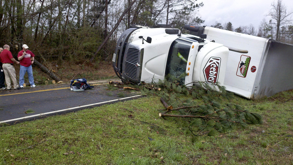 Photo -   A semitrailer lies flipped near Sparkman High School on Jeff Road after a reported tornado came through Harvest, Ala., Friday, March 2, 2012. (AP Photo/The Huntsville Times, Eric Schultz)
