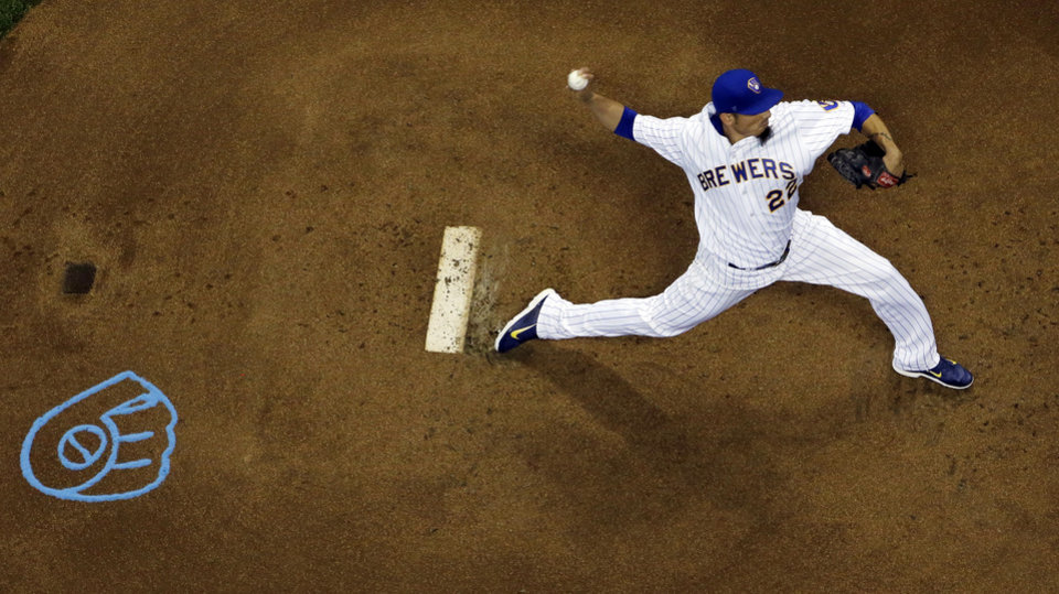 Photo - Milwaukee Brewers starting pitcher Matt Garza throws during the first inning of a baseball game against the Cincinnati Reds Friday, June 13, 2014, in Milwaukee. (AP Photo/Morry Gash)