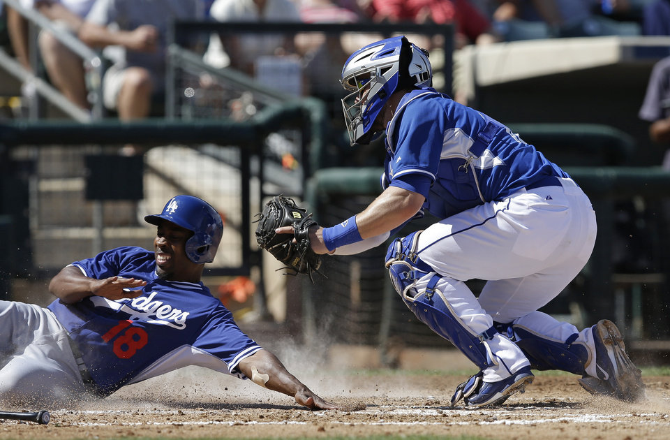 Photo - CORRECTS SPELLING OF SURPRISE - Los Angeles Dodgers' Chone Figgins is tagged out by Kansas City Royals catcher Brett Hayes during the third inning of an exhibition baseball game Tuesday, March 11, 2014, in Surprise, Ariz. (AP Photo/Darron Cummings)
