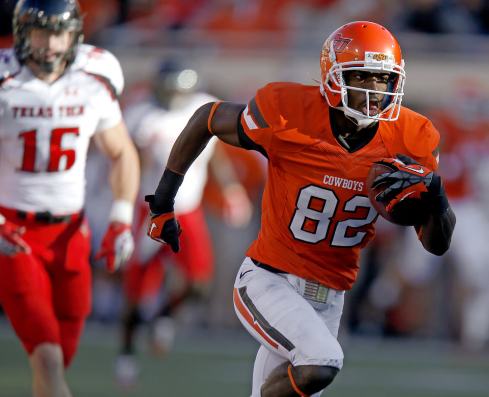 Photo - Oklahoma State's Isaiah Anderson (82) scores a touchdown during a college football game between Oklahoma State University (OSU) and Texas Tech University (TTU) at Boone Pickens Stadium in Stillwater, Okla., Saturday, Nov. 17, 2012.  Photo by Bryan Terry, The Oklahoman