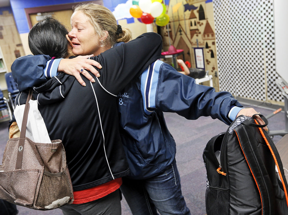 Jacquie Nayphe, right, and Maria Hannigan hug during a meet and greet with teachers and students from Plaza Towers Elementary at Eastlake Elementary School in Oklahoma City, Thursday, May 23, 2013. Seven Plaza Towers students died when a tornado destroyed the school in Moore, Okla., on Monday. Nayphe's son Cort Nayphe, 9, is a 3rd-grader at Plaza Towers. Hannigan's daughter Zandria Hannigan, 10, is also a 3rd-grader there. Photo by Nate Billings, The Oklahoman