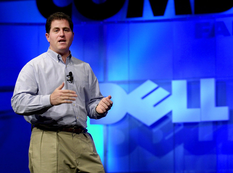 FILE - In this Monday, Nov. 13, 2000 photo, Michael Dell, Chairman and CEO of Dell, speaks during his keynote address at Comdex, in Las Vegas. It\'s easy to forget now, but Michael Dell was the Mark Zuckerberg of his time. Hailed as a young genius, he created the inexpensive, made-to-order personal computer in his dorm room and peddled it to the masses, but now the PC is being eclipsed by smartphones and tablet computers, and Dell is trying to save his company. (AP Photo/Mark J. Terrill, FIle)
