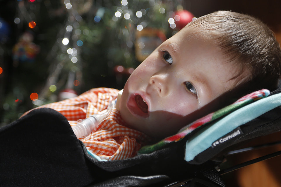 Photo - Kayden Chaffin takes a picture at his home in Noble, Okla., Tuesday, Dec. 6, 2016. Chaffin has spinal muscular atrophy, a genetic illness and his family collects Christmas cards for him. Photo by Sarah Phipps, The Oklahoman
