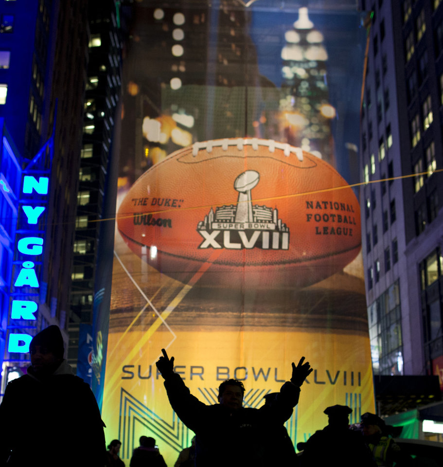 Photo - Fans gather on the Super Bowl Boulevard in Times Square on Friday, Jan. 31, 2014, in New York. The Seattle Seahawks will play the Denver Broncos on Sunday in NFL football's Super Bowl XLVIII in East Rutherford, N.J. (AP Photo/ Evan Vucci)