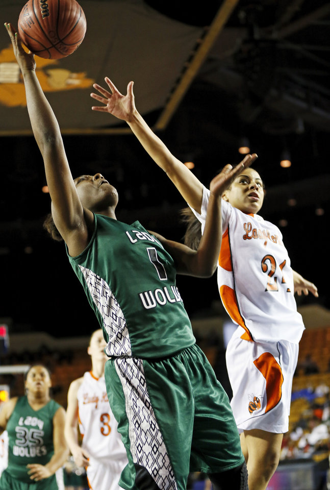 Photo - Edmond Santa Fe's Aahliyah Jackson (1) takes a shot past Booker T. Washington's Mikayla Alexander (24) during a Class 6A girls high school basketball game in the semifinals of the state tournament at the Mabee Center in Tulsa, Okla., Friday, March 8, 2013. Photo by Nate Billings, The Oklahoman