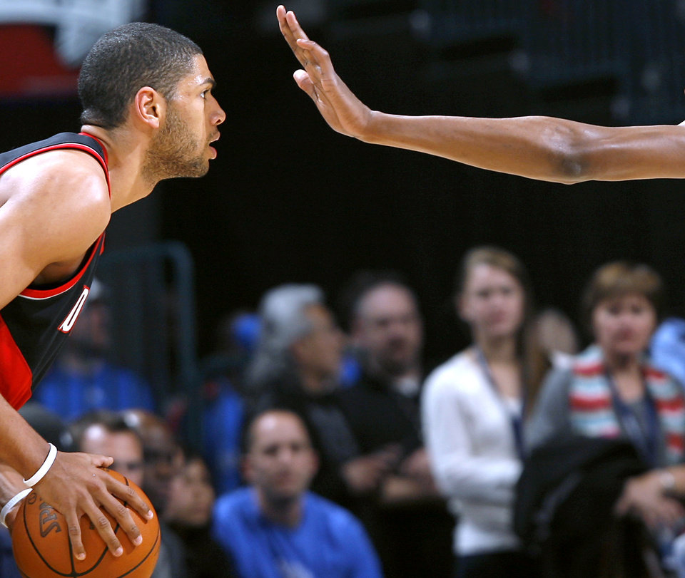 Photo - Portland's Nicolas Batum is pressured by Oklahoma City's Kevin Durant during their NBA basketball game at the Ford Center in Oklahoma City, Okla., on Sunday, March 28, 2010. Photo by John Clanton, The Oklahoman