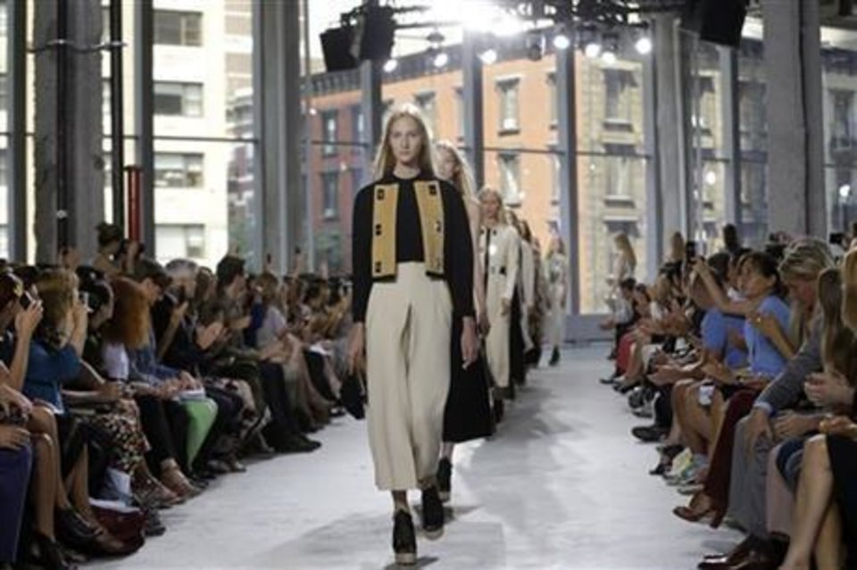 Photo -  The Proenza Schoulder spirng 2014 collection shown on the runway in New York. AP