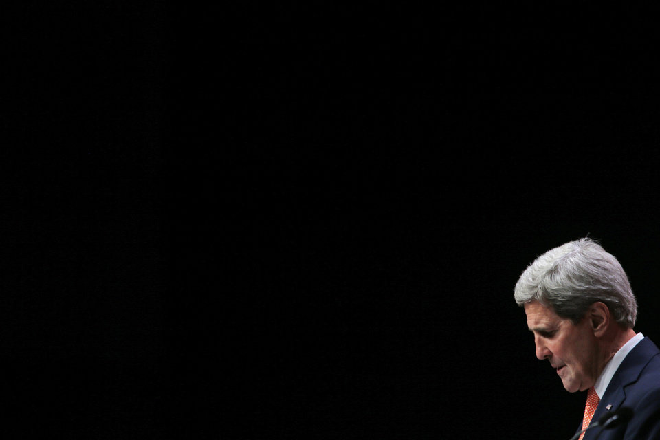 Photo - US Secretary of State John Kerry listens to a reporter's question during a news conference at the conclusion of the 'End Sexual Violence in Conflict' summit in London, Friday, June 13, 2014. The Summit welcomed governments from over 100 countries, over 900 experts, NGOs, Faith leaders, and representatives from international organisations across the world. (AP Photo/Lefteris Pitarakis)