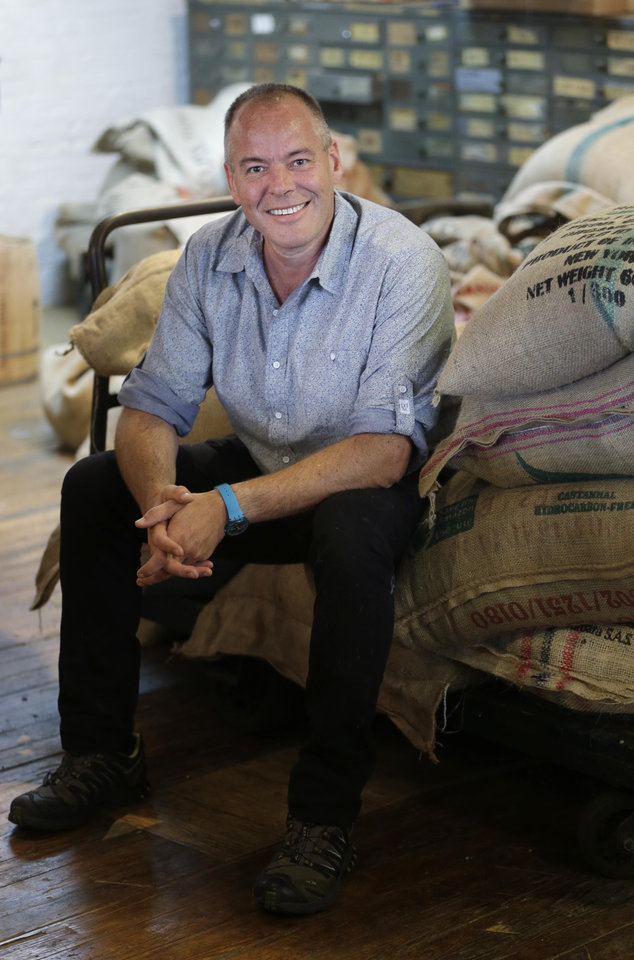 Photo - In this July 14, 2014 photo, Jim Munson, owner of Brooklyn Roasting Company, poses for photos in New York. Sales of the company's Free Trade coffee have soared from $900,000 in 2011 to $4.4 million last year, and are expected to reach $6 million in 2014. (AP Photo/Seth Wenig)