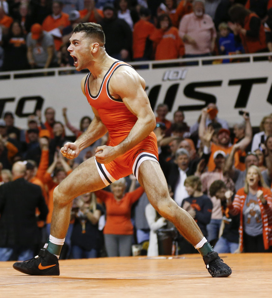 Photo - OSU's Nick Piccininni reacts after pinning Iowa's Spencer Lee, not pictured, in a 125-pound match during a college wrestling dual between the Oklahoma State Cowboys and the Iowa Hawkeyes at Gallagher-Iba Arena in Stillwater, Okla., Sunday, Feb. 24, 2019. OSU won 27-12. Photo by Nate Billings, The Oklahoman