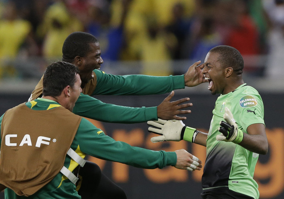 """Photo - FILE-In this file photo taken Sunday, Jan. 27, 2013. South Africa's goalkeeper Itumeleng Khune, right, celebrates with fellow goalkeepers Wayne Sandilands, left, and Senzo Meyiwa after drawing with Morocco to advance to the quarterfinals of the African Cup of Nations, in Durban, South Africa. Now, South Africa is nowhere _ not even among the 31 teams that qualified for this year's World Cup in Brazil. Well, not exactly nowhere. It is on FIFA's radar for an investigation into match-fixing allegations. And it is still in the news at home _ for the wrong reasons: Sports minister Fikile Mbalula last month called the national side """"a bunch of losers"""" and """"useless, unbearable individuals"""" after early elimination on home soil from the lower-level African Nations Championship.(AP Photo/Rebecca Blackwell, File)"""