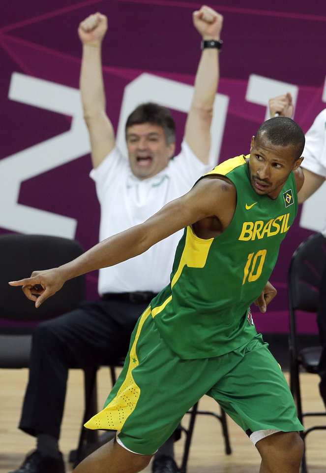 Brazil\'s Leandrinho Barbosa reacts after scoring a three point shot during a preliminary men\'s basketball game against Spain at the 2012 Summer Olympics, Monday, Aug. 6, 2012, in London. (AP Photo/Victor R. Caivano)