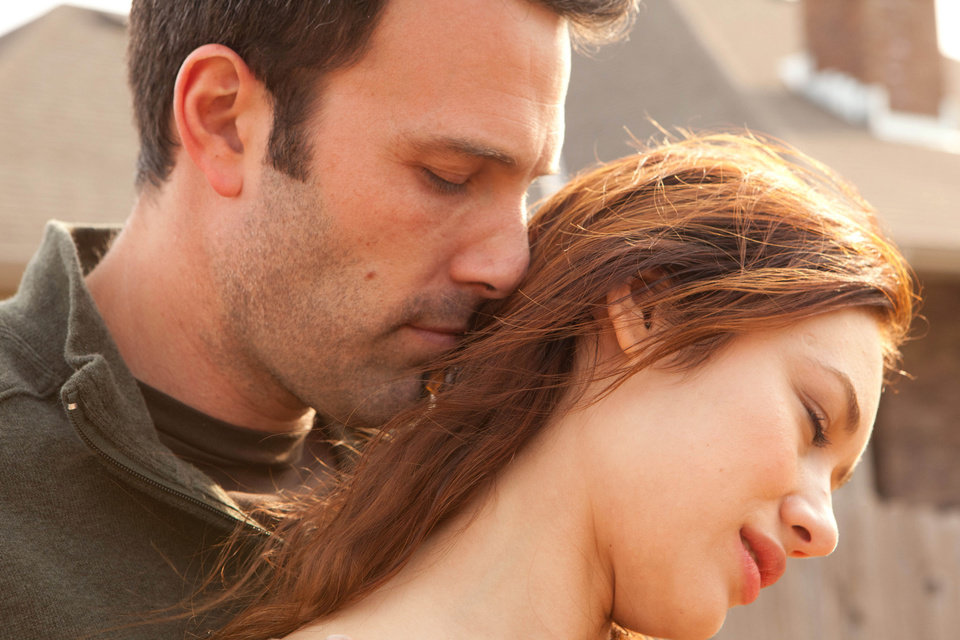 Photo - This undated photo provided by Magnolia Pictures shows Ben Affleck and Olga Kurylenko in a scene from