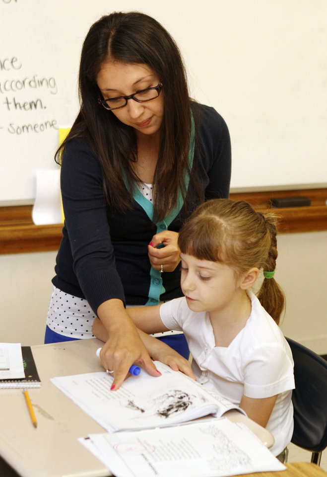 Instructor Deivi Santizo works with student Elizabeth Vanderhoof during a summer reading program at Heronville Elementary School in Oklahoma City, OK, Thursday, June 13, 2013,  Photo by Paul Hellstern, The Oklahoman