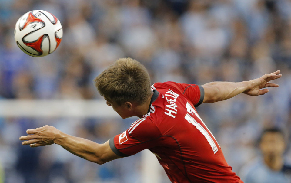 Photo - Toronto FC defender Nick Hagglund heads the ball during the first half of an MLS soccer match against Sporting Kansas City in Kansas City, Kan., Friday, May 23, 2014. (AP Photo/Orlin Wagner)