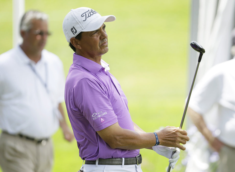 Photo - Tom Pernice Jr. watches his shot off the first tee during the final round of the Champions Tour's Principal Charity Classic golf tournament on Sunday, June 1, 2014, in Des Moines, Iowa. (AP Photo/Charlie Neibergall)