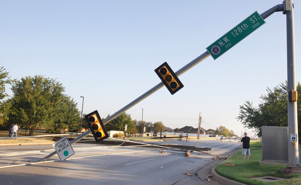 Photo - Street signals and power lines down along Rockwell Ave. at NW 128 Street, the entrance to Francis Tuttle Vo Tech, in Oklahoma City Tuesday, Aug. 9, 2011. A thunderstorm moved through the area Monday evening causing storm damage. Photo by Paul B. Southerland, The Oklahoman