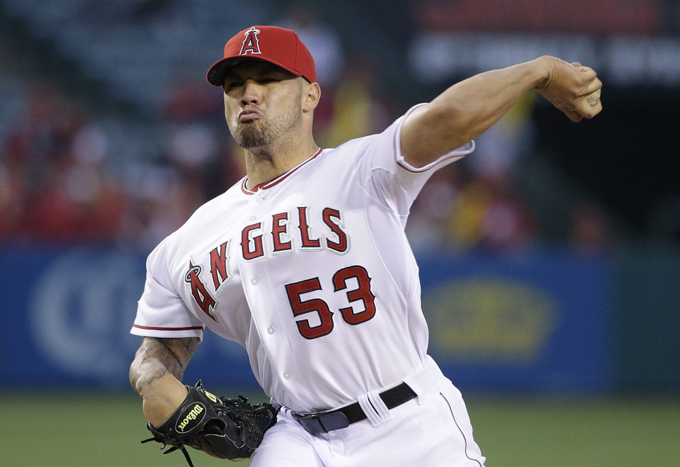 Photo - Los Angeles Angels starting pitcher Hector Santiago throws to a Seattle Mariners batter during the first inning of a baseball game Wednesday, April 2, 2014, in Anaheim, Calif. (AP Photo/Jae C. Hong)