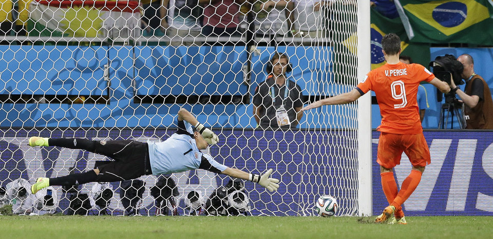 Photo - Netherlands' Robin van Persie scores in a penalty shoot out during the World Cup quarterfinal soccer match between the Netherlands and Costa Rica at the Arena Fonte Nova in Salvador, Brazil, Saturday, July 5, 2014. The Netherlands won 4-3 0n penalties after the match ended 0-0 after extra time. (AP Photo/Matt Dunham)