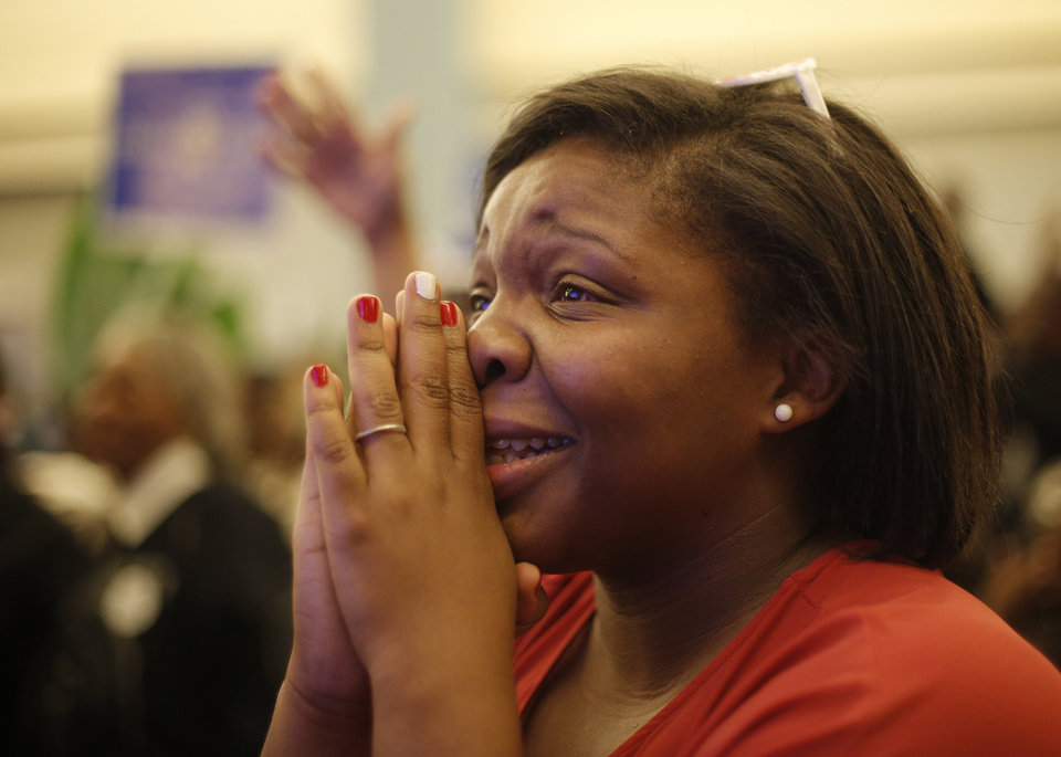 Tiffany Thompson reacts as President Obama wins the 2012 election during the Oklahoma Democratic Party watch gathering at the Reed Center in Midwest City, Tuesday, Nov. 6, 2012.  Photo by Garett Fisbeck, The Oklahoman