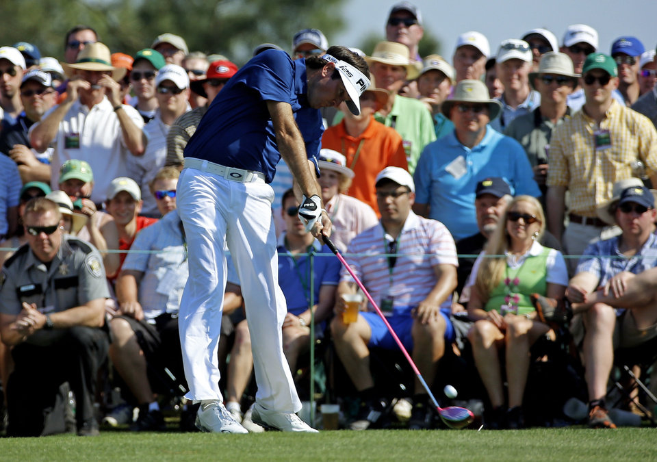 Photo - Bubba Watson tees off on the eighth hole during the third round of the Masters golf tournament Saturday, April 12, 2014, in Augusta, Ga. (AP Photo/David J. Phillip)