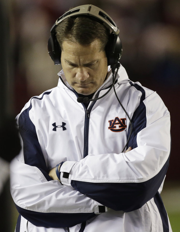 Photo - Auburn coach Gene Chizik walks the sidelines during the second half of a 49-0 loss to Alabama in a NCAA college football game at Bryant-Denny Stadium in Tuscaloosa, Ala., Saturday, Nov. 24, 2012. Chizik was fired Sunday after a 3-8 season by Athletic Director Jay Jacobs. (AP Photo/Dave Martin)