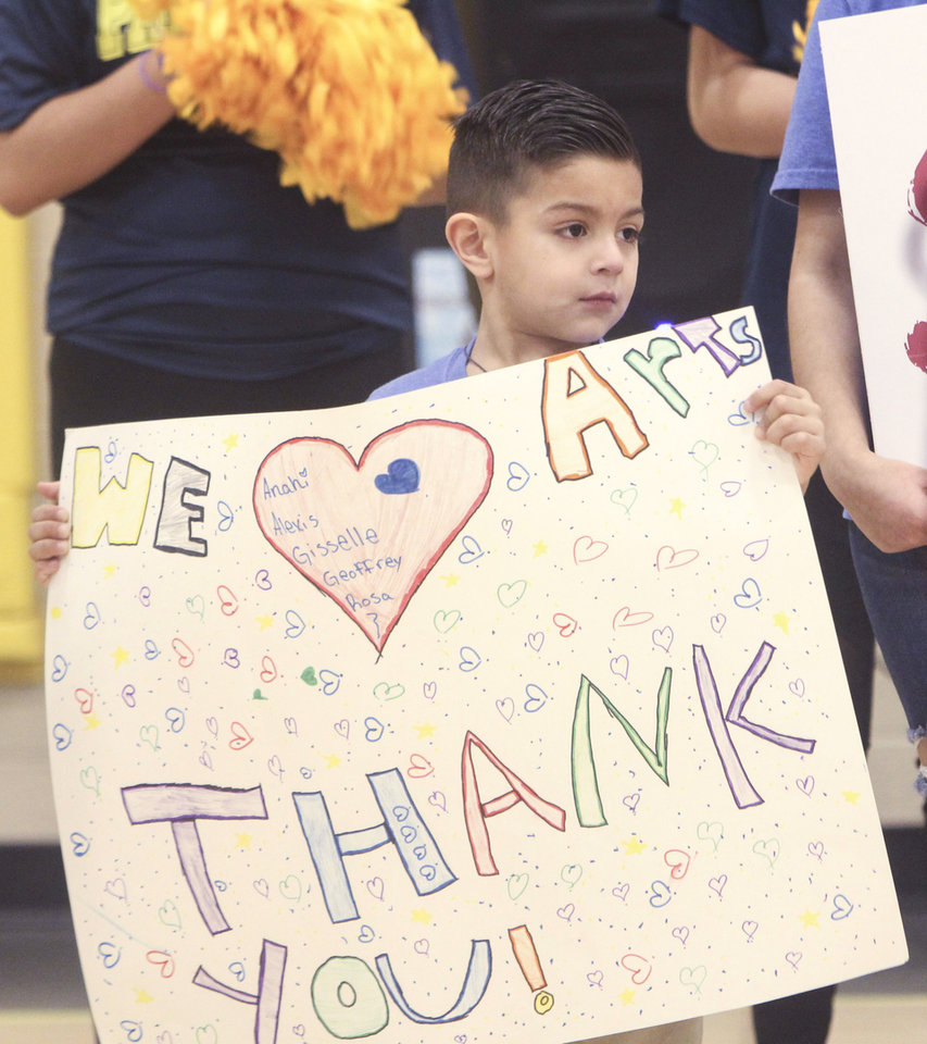 Photo -  A Pierce Elementary School student shows his appreciation for a $160,000 donation to extend and expand arts education at Oklahoma City district schools with limited budgets. [Photo provided]
