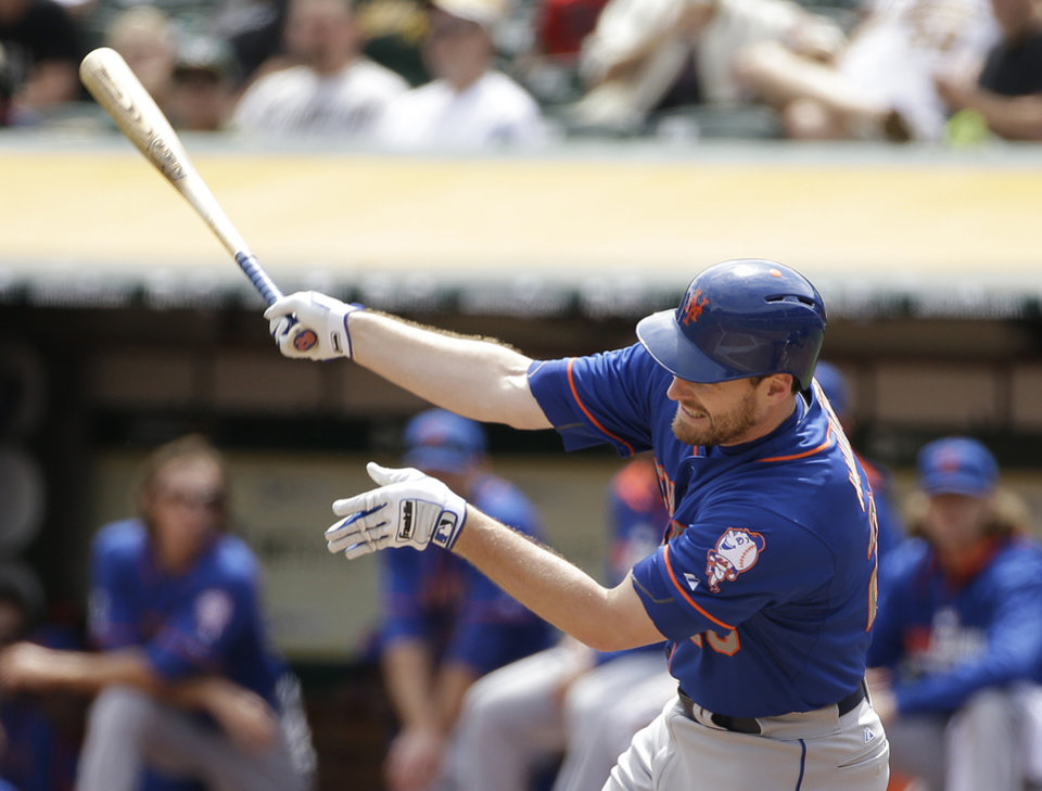 Photo - New York Mets' Daniel Murphy strikes out swinging against Oakland Athletics starting pitcher Jeff Samardzija in the first inning of their interleague baseball game Wednesday, Aug. 20, 2014, in Oakland, Calif. (AP Photo/Eric Risberg)