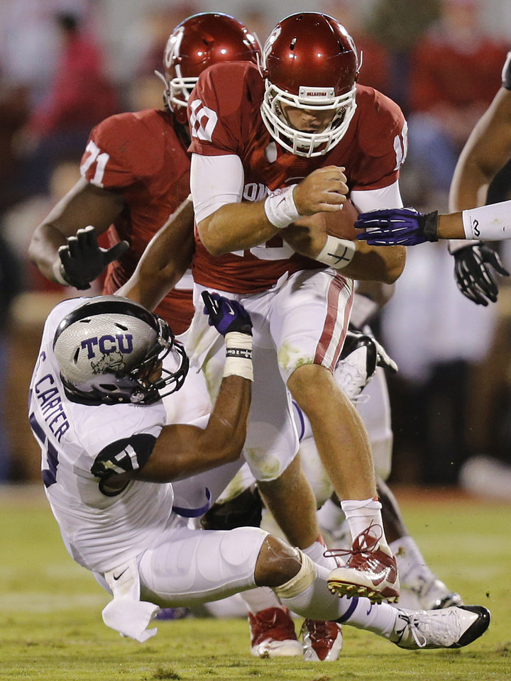 Oklahoma\'s Blake Bell (10) runs over TCU \'s Sam Carter (17) on his way to a first down to seal the 20-17 win during the college football game between the University of Oklahoma Sooners (OU) and the Texas Christian University Horned Frogs (TCU) at the Gaylord Family-Oklahoma Memorial Stadium on Saturday, Oct. 5, 2013 in Norman, Okla. Photo by Chris Landsberger, The Oklahoman