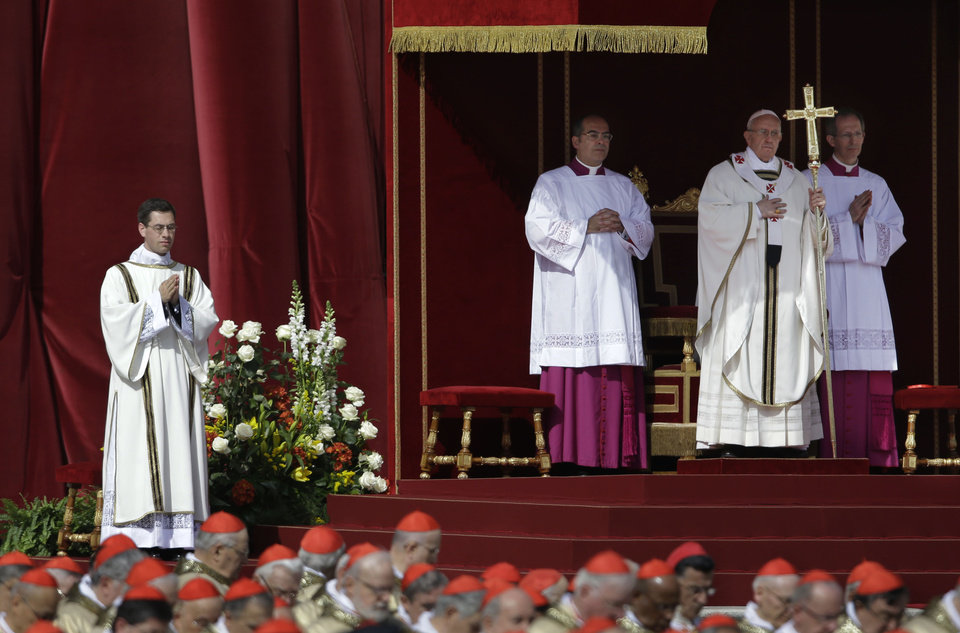 Pope Francis stands at the steps of St. Peter's Basilica during his inaugural Mass in St. Peter's Square at the Vatican, Tuesday, March 19, 2013. (AP Photo/Gregorio Borgia)