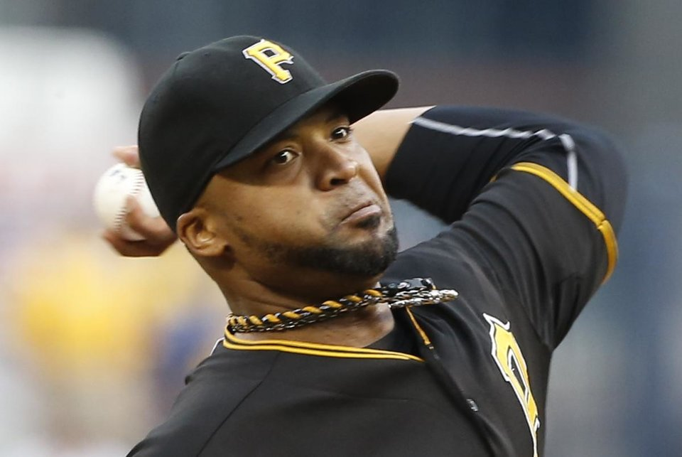 Photo - Pittsburgh Pirates starting pitcher Francisco Liriano throws against the St. Louis Cardinals in the first inning of a baseball game on Friday, May 9, 2014, in Pittsburgh. (AP Photo/Keith Srakocic)