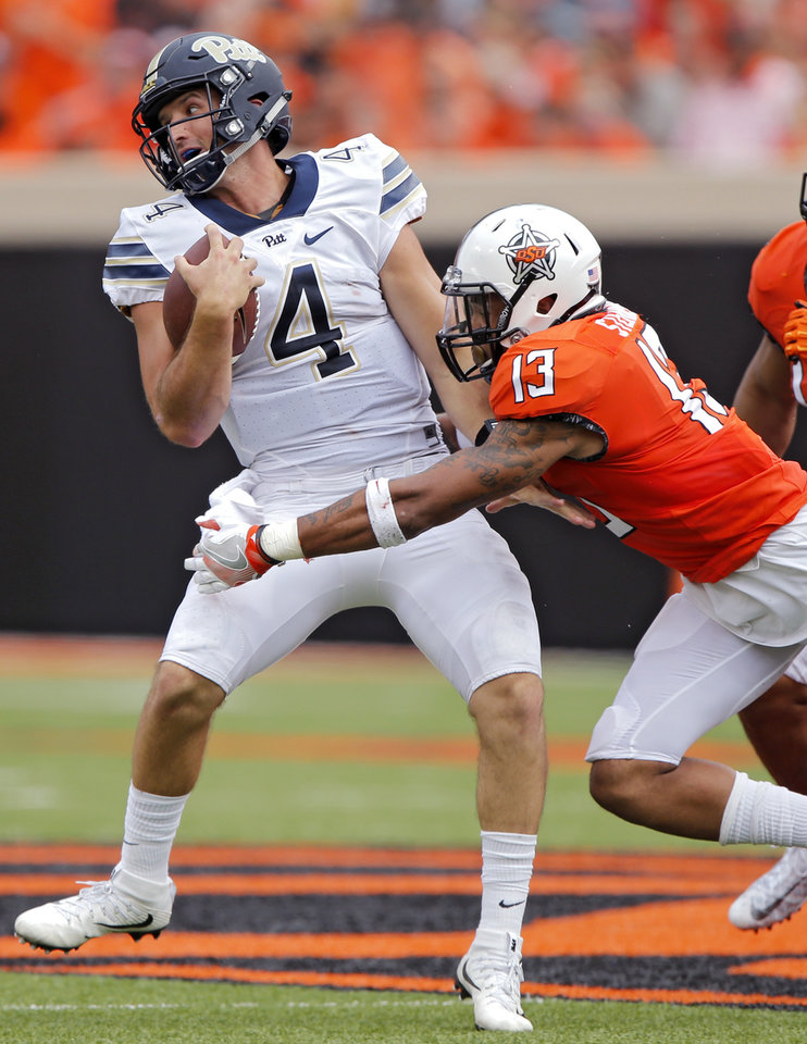 Photo - Oklahoma State's Jordan Sterns (13) sacks Pittsburgh's Nathan Peterman (4) during a college football game between the Oklahoma State Cowboys (OSU) and the Pitt Panthers at Boone Pickens Stadium in Stillwater, Okla., Saturday, Sept. 17, 2016. Photo by Chris Landsberger, The Oklahoman