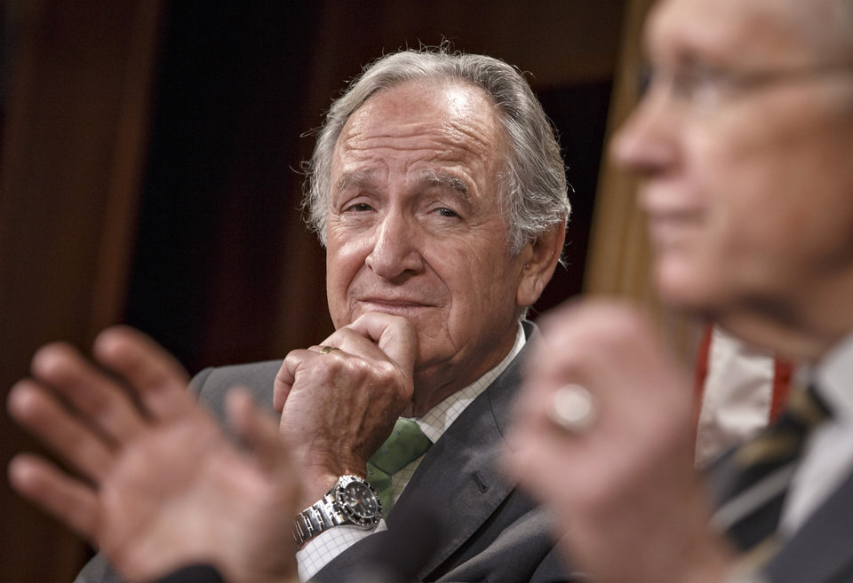 Photo - Sen. Tom Harkin, D-Iowa, sponsor of the Minimum Wage Fairness Act, listens to Senate Majority Leader Harry Reid, D-Nev., right, listens during a news conference on Capitol Hill in Washington, Wednesday, April 30, 2014, after the bill to raise the minimum wage to $10.10 was stopped on a procedural vote. Senate Republicans blocked the election-year Democratic bill, handing a defeat to President Barack Obama on a vote that is sure to reverberate in this year's congressional contests. (AP Photo)
