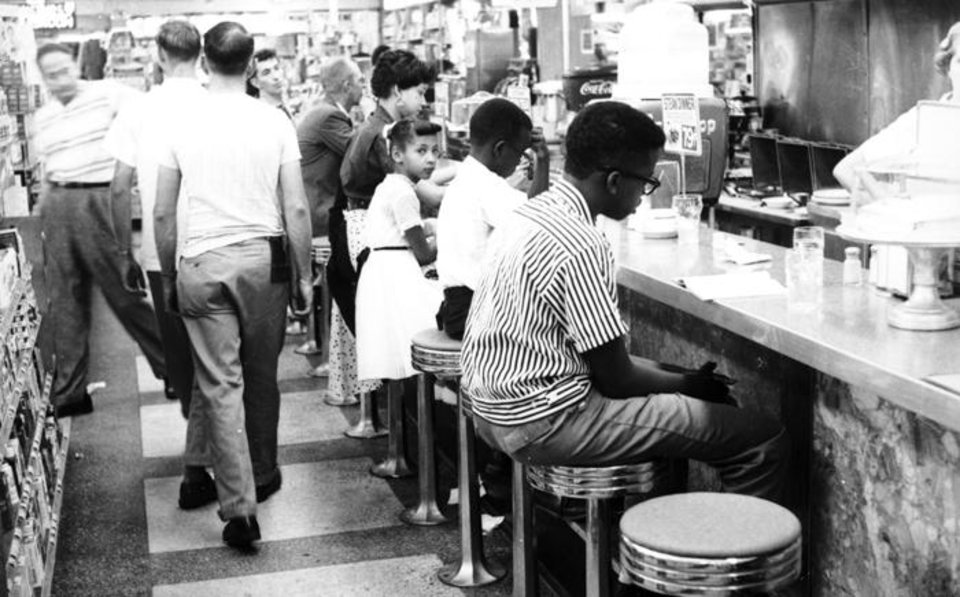Photo -  Students participate in the 1958 sit-in at Katz Drug in Oklahoma City. Oklahoman Archives