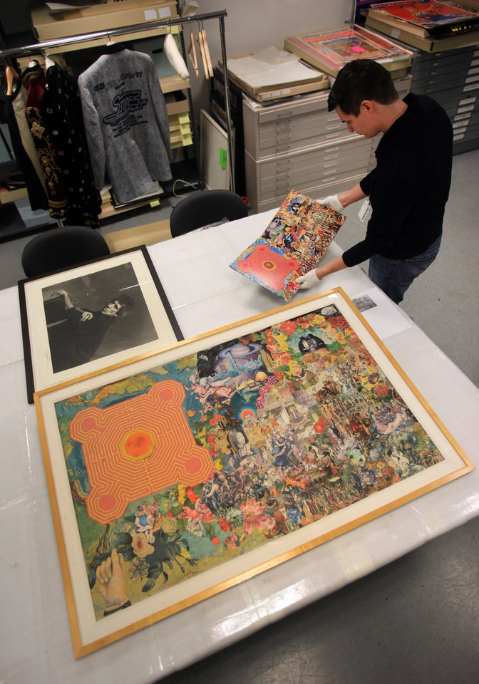 Photo - In this Tuesday, Feb. 26, 2013 photo, Matt Seaman, collections assistant, handles the Rolling Stones album