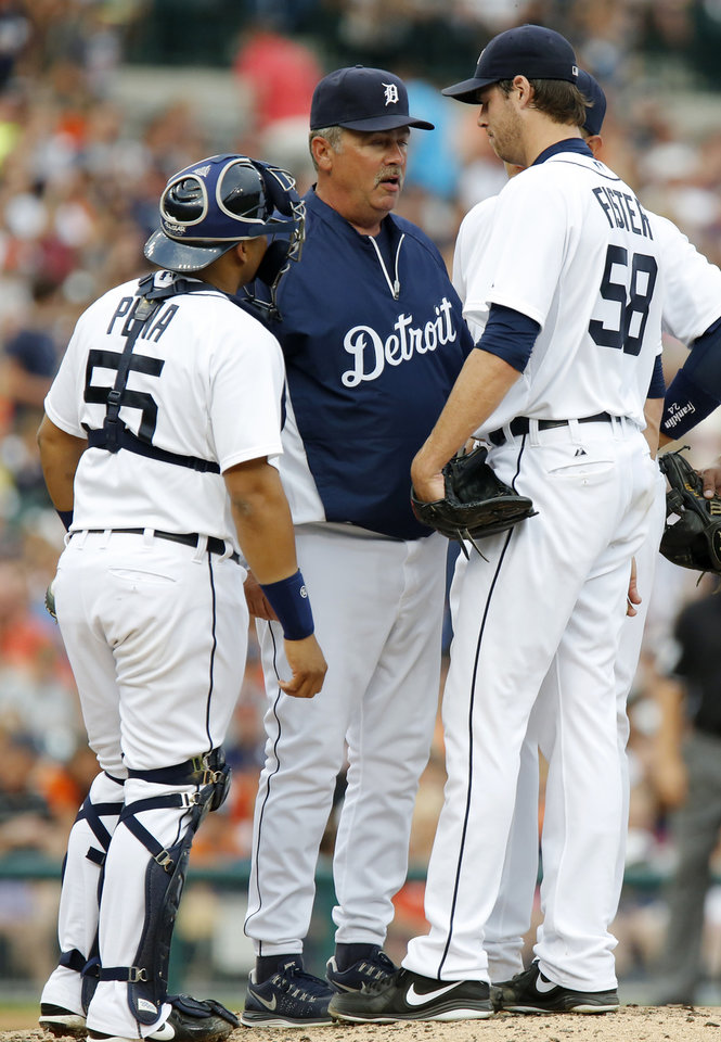 Detroit Tigers starter Doug Fister, right, is visited on the mound by pitching coach Jeff Jones, center, and catcher Brayan Pena after loading the bases in the fourth inning of a baseball game against the Boston Red Sox, Friday, June 21, 2013, in Detroit. (AP Photo/Duane Burleson)
