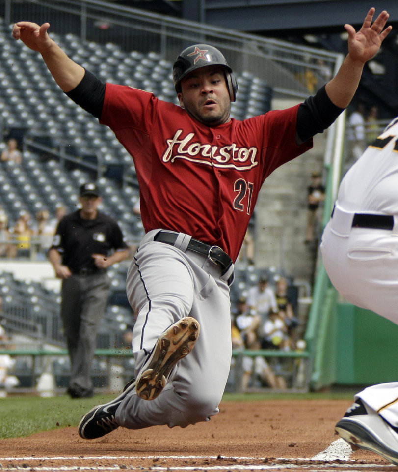Photo -   Houston Astros' Jose Altuve (27) is forced out at home plate on an infield grounder by Astros' Justin Maxwell in the first inning of a baseball game in Pittsburgh Monday, Sept. 3, 2012. (AP Photo/Gene J. Puskar)