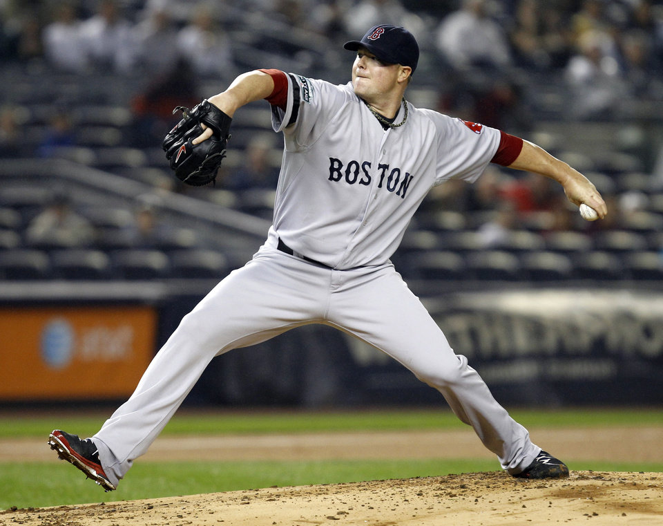 Boston Red Sox starting pitcher Jon Lester delivers in the first inning of a baseball game against the New York Yankees at Yankee Stadium in New York, Tuesday, Oct. 2, 2012. (AP Photo/Kathy Willens)