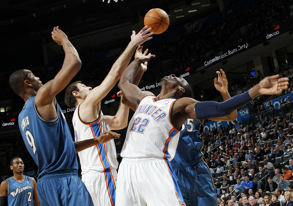 Photo - Washington's Rashard Lewis (9) and Oklahoma City's Nenad Krstic (12) and Jeff Green (22) try to control the ball during the NBA basketball game between the Washington Wizards and the Oklahoma City Thunder at the Oklahoma City Arena in Oklahoma City, Friday, January 28, 2011. The Thunder won, 124-117, in double overtime. Photo by Nate Billings, The Oklahoman